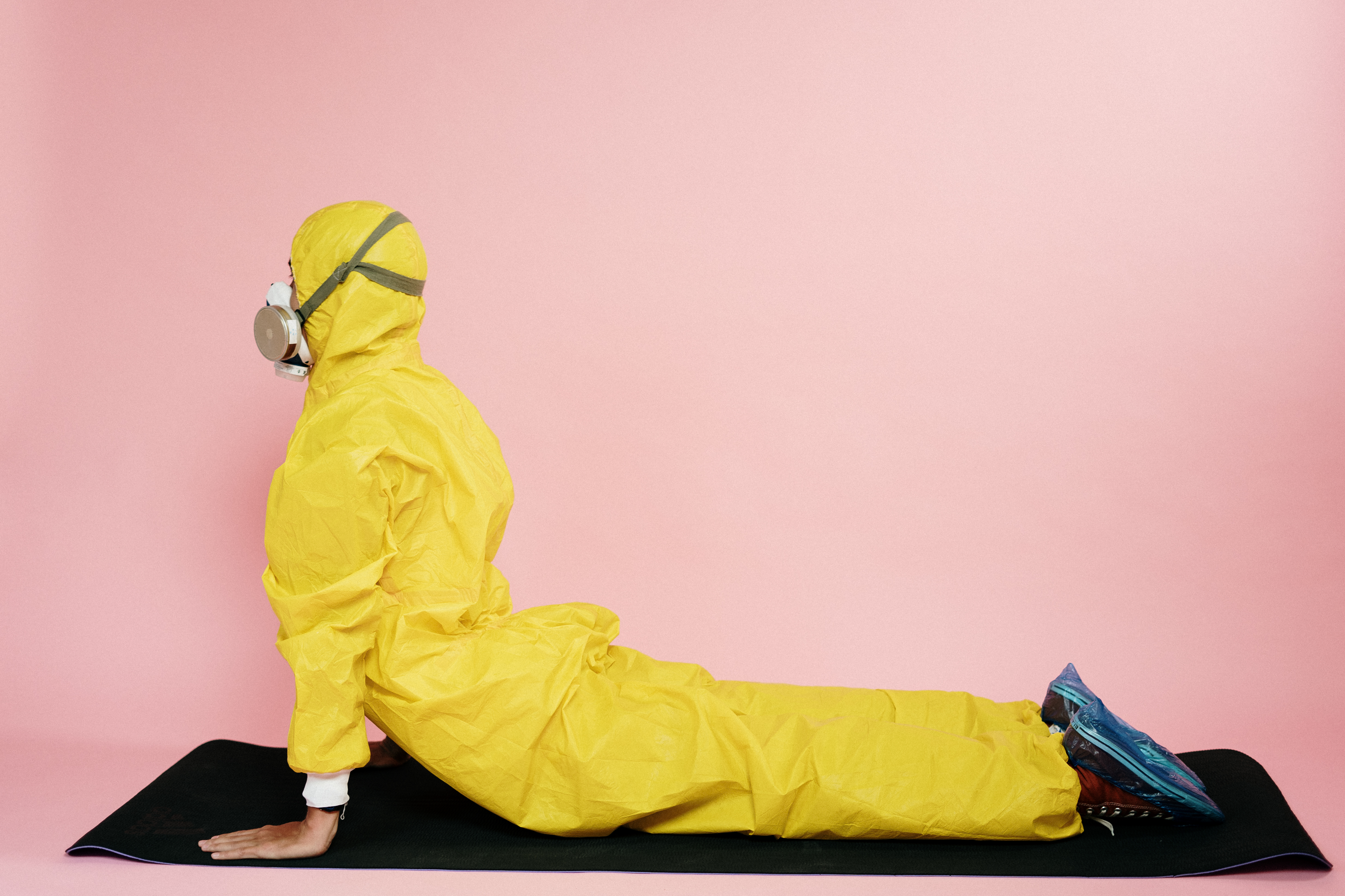 canva-man-in-yellow-protective-suit-stretching